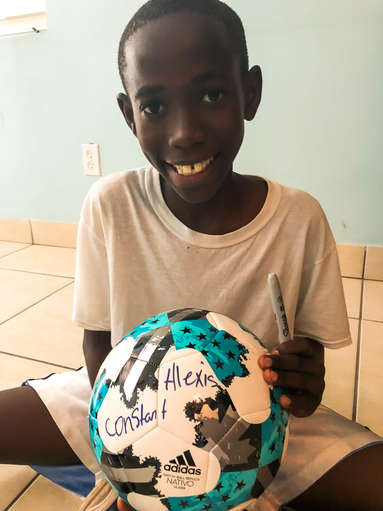 Alexis receives a soccer ball from Charity Ball