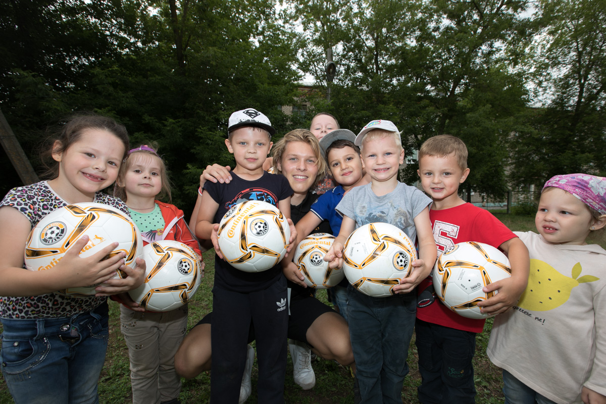 Ethan King delivers soccer balls to kids in Russia during the 2018 World Cup